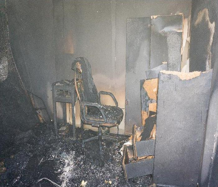 chair and furniture in room after burned